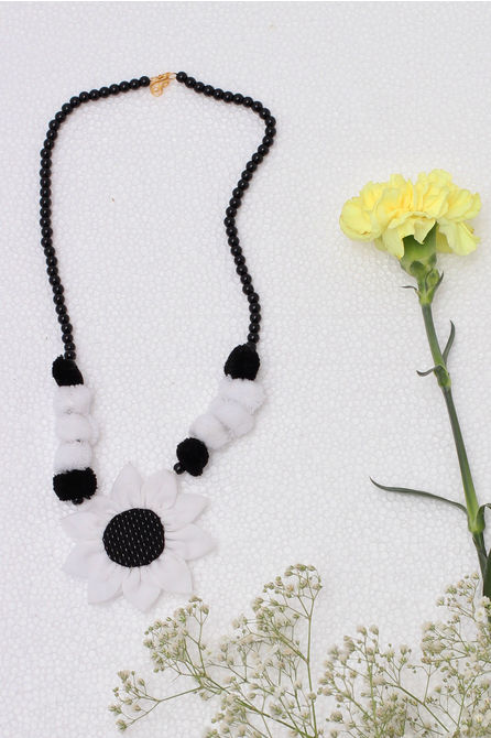 BLACK & WHITE SUNFLOWER NECKPIECE